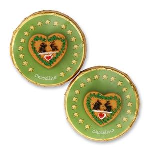 Chocotaler dekoriert mit grünem Herz